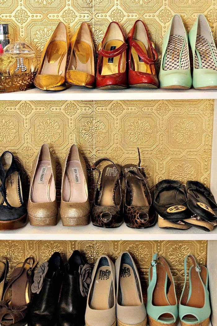 """""""I still have my feet on the ground, I just wear better shoes."""" -- OprahLearn how to transform a bookshelf you already have using wallpaper at Classy Clutter."""