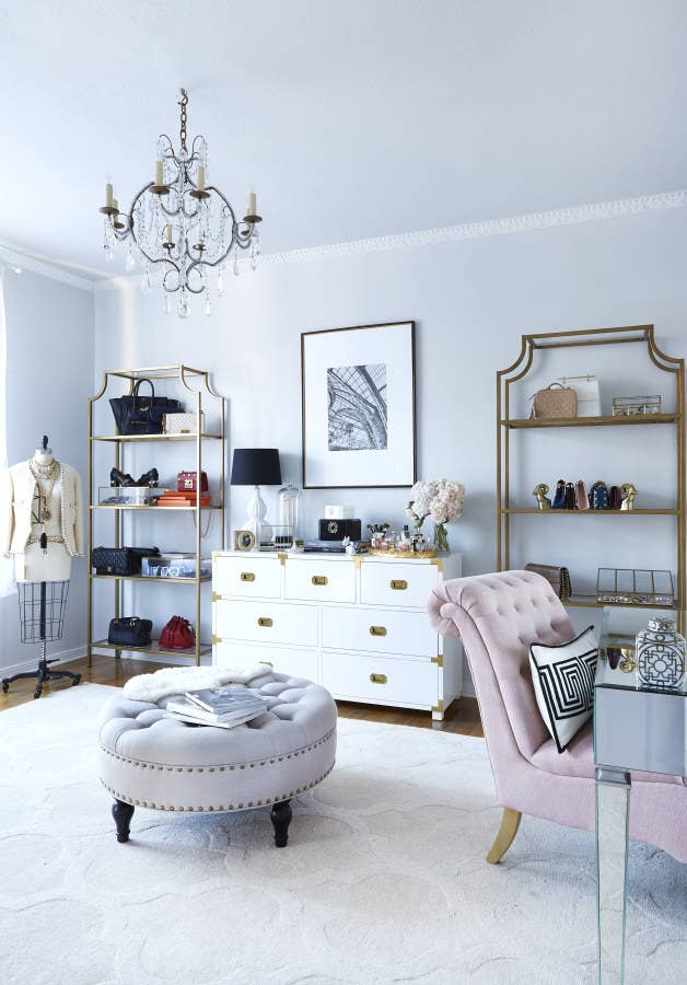 To do this yourself, you can use a pretty garment rack or decorative shelves like the ones above. Get the look for less by spray painting these $79.99 Ikea shelves. This is actually a picture of the Margo & Me offices, but they're basically a dream closet. See more pictures of the tour here.