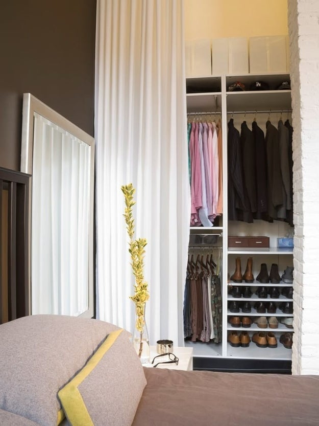 Or hang a curtain from the ceiling to hide everything away.
