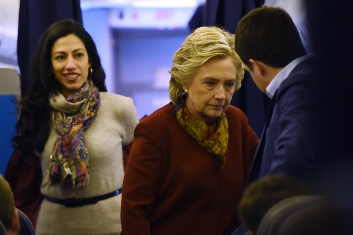 Hillary Clinton and Huma Abedin (left) aboard her plane in October 2016.