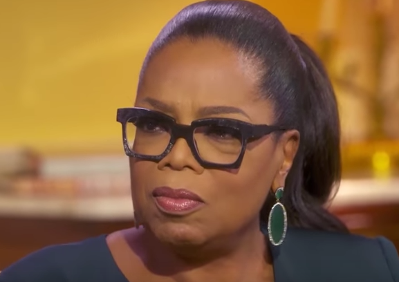 LOOK AT HOW THE LIGHT HITS OPRAH'S THRIVING PONYTAIL! THERE'S NOT A HAIR FOLLICLE OUT OF PLACE!