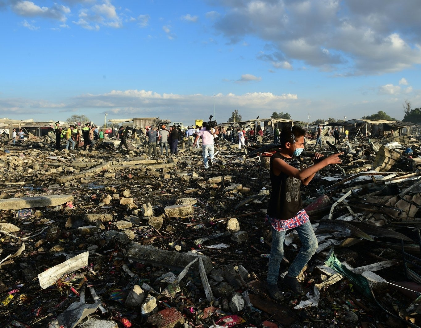Local residents search among the debris.