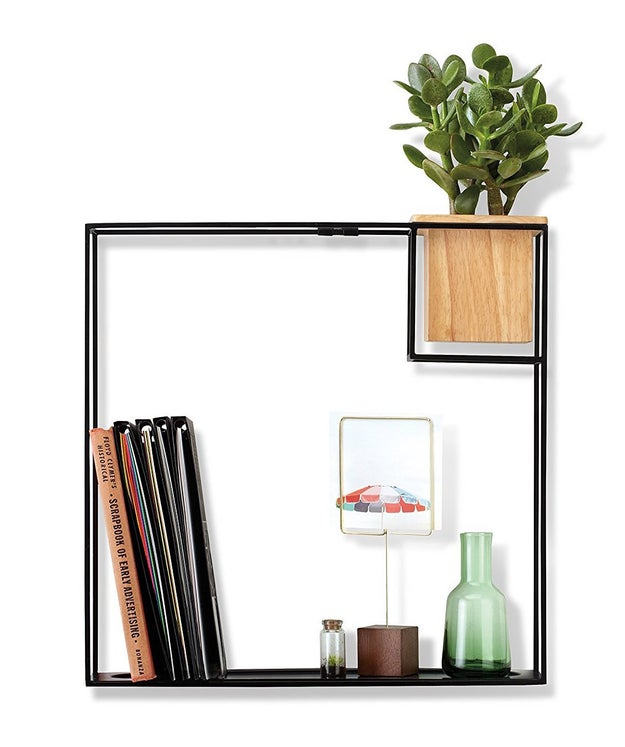 A black wire wall shelf that's easy on the eyes.