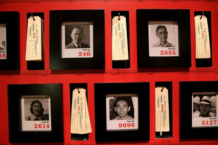 Pictures of people who were incarcerated at Manzanar War Relocation Center are displayed alongside family tags at Manzanar National Historic Site.