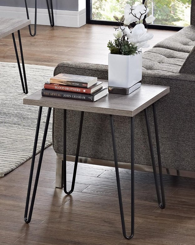 """A gunmetal end table that says, """"I have enough books and flowers to go around."""""""