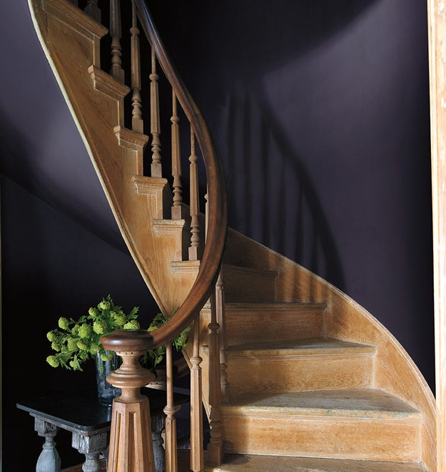 And give a boring corner of your home some ambience with a rich, moody paint color.
