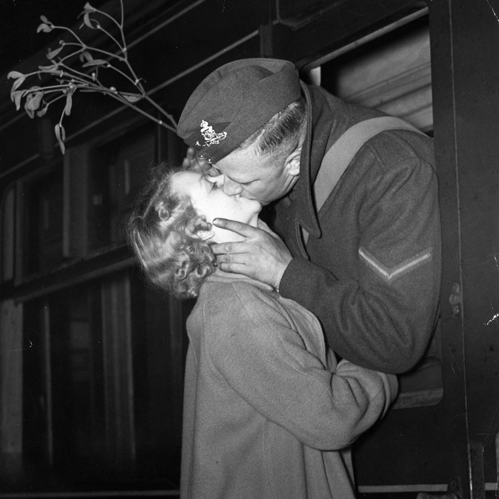 And this soldier stealing one last kiss under the mistletoe before shipping off in 1939.