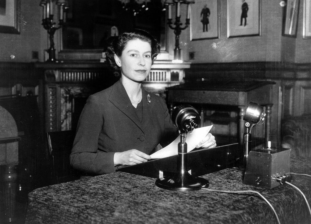 A young Queen Elizabeth giving her first-ever Christmas broadcast to the nation in 1952.