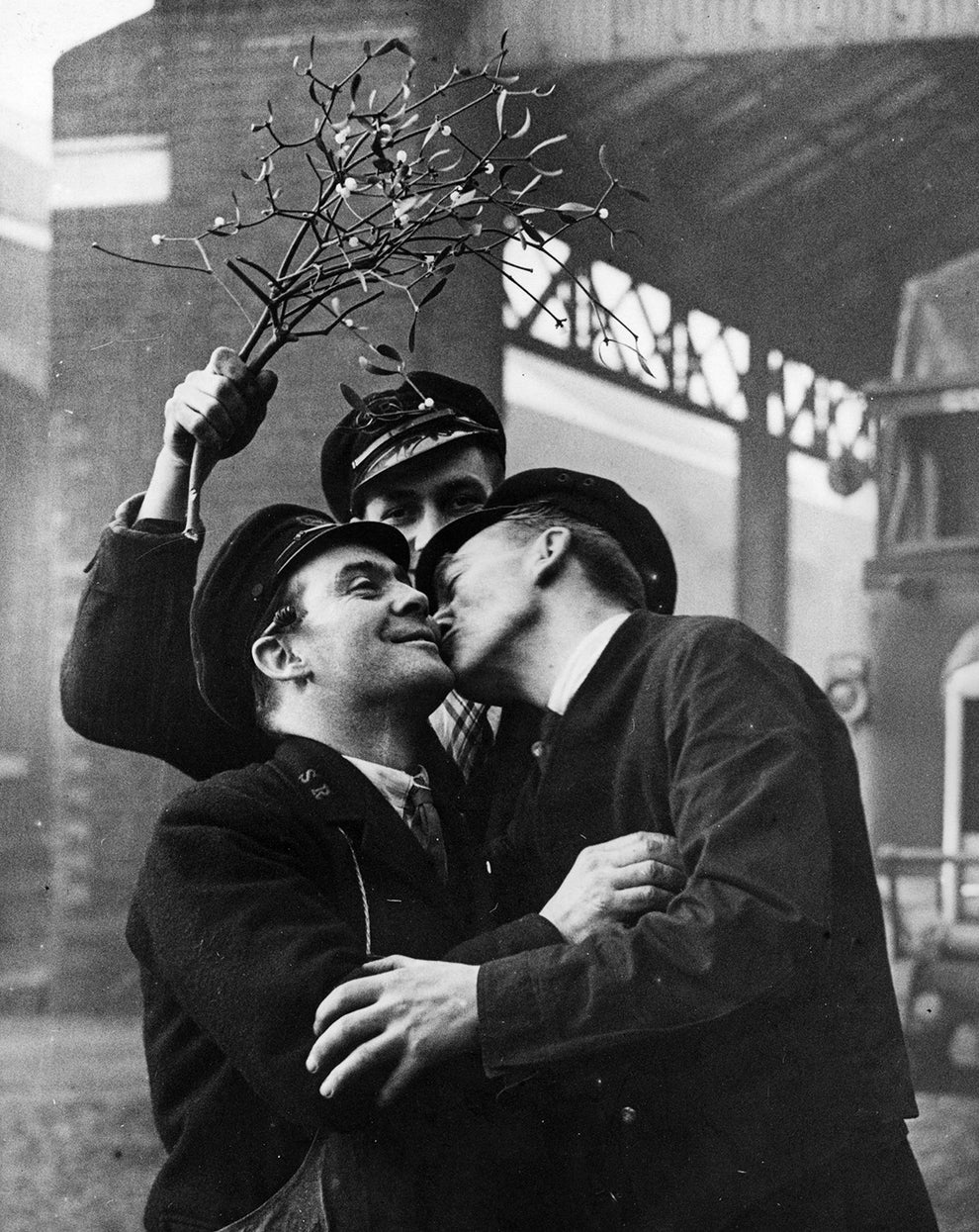 This jolly pair caught unexpectedly under the mistletoe in 1937.