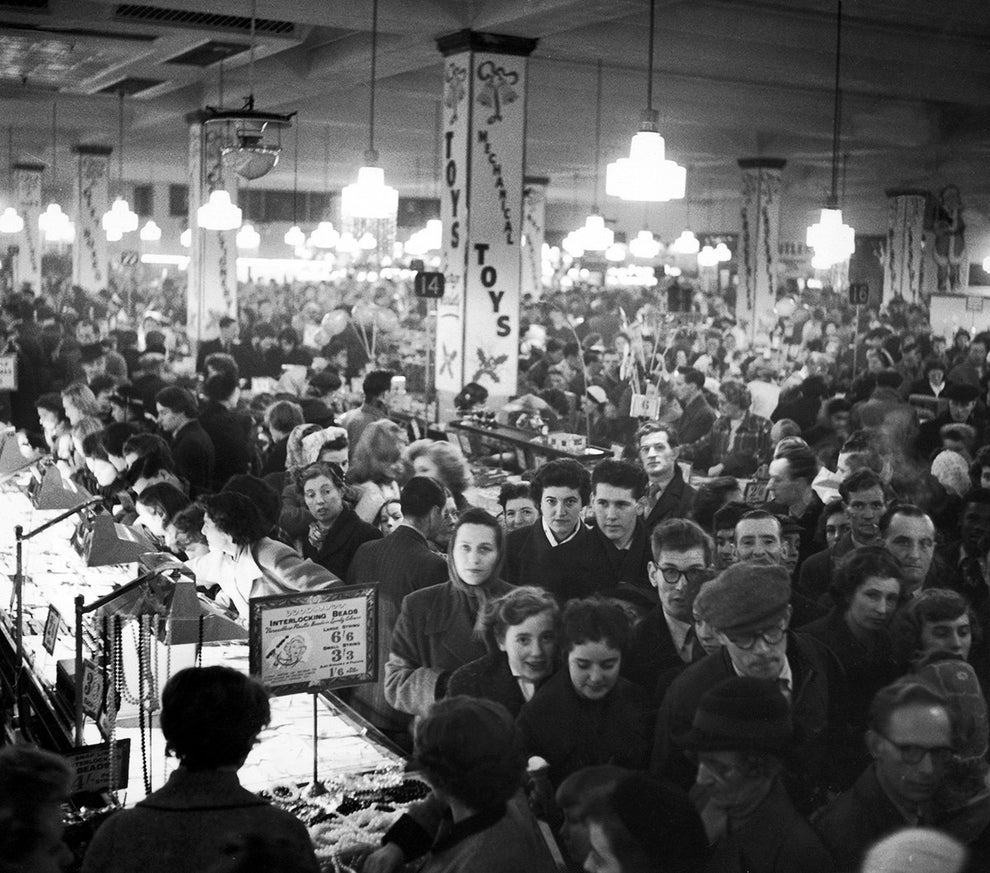 The chaotic bustle of holiday shopping at London's Woolworths store in 1955.