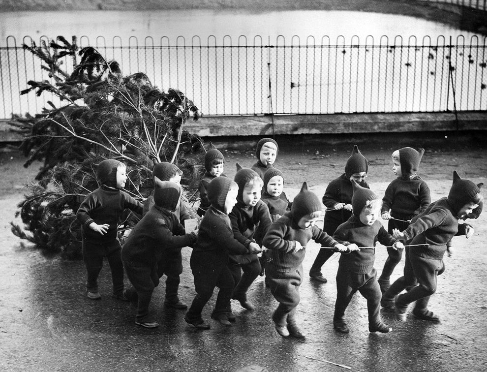 This group of holiday munchkins from the Homeless Children's Aid and Adoption Society in London, trying their best to lend a helping hand in 1938.