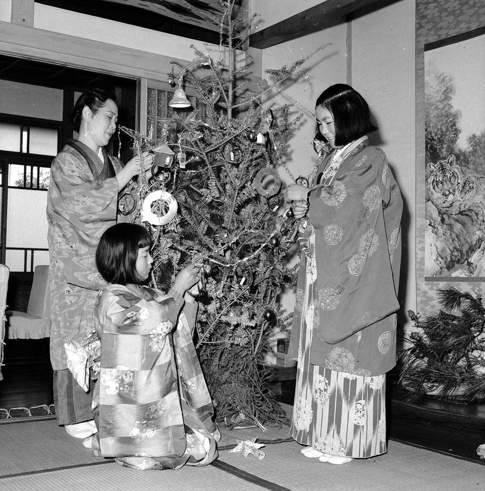 This kimono-clad family decorating their Christmas tree in Yokohama, Japan, circa 1950.