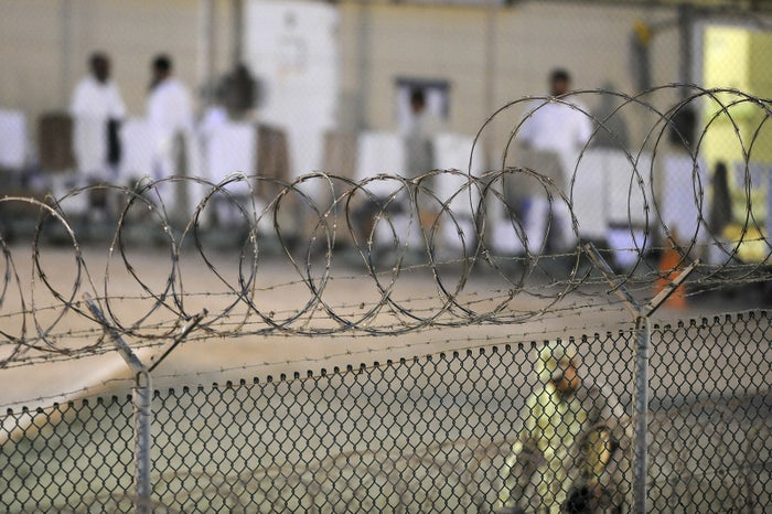 A Navy guard patrols a detainee recreation yard at the Guantánamo Bay naval base.