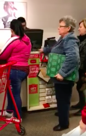 """She then turns to the cashier, and asks him, """"Tell them to go back to where they belong.""""The woman is seen and heard shouting a slew of racially charged statements at the customers at the register, including making an assumption they're on welfare. """"Prey[ing] on welfare,"""" she said. """"The taxpayers probably paid for all that stuff."""""""