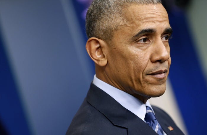 U.S. President Barack Obama pauses as he participates in his last news conference of the year at the White House