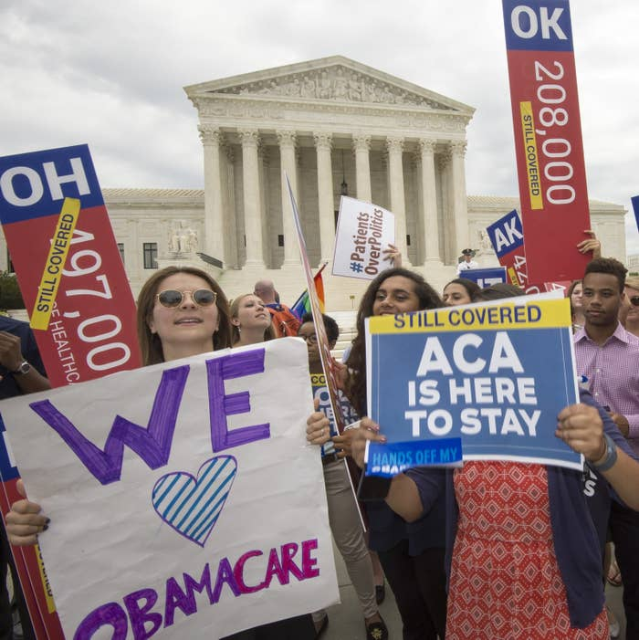 Supporters rally in front of the Supreme Court after the court's announcment of the decision affirming the Affordable Care Act on June 25, 2015, in Washington, DC.