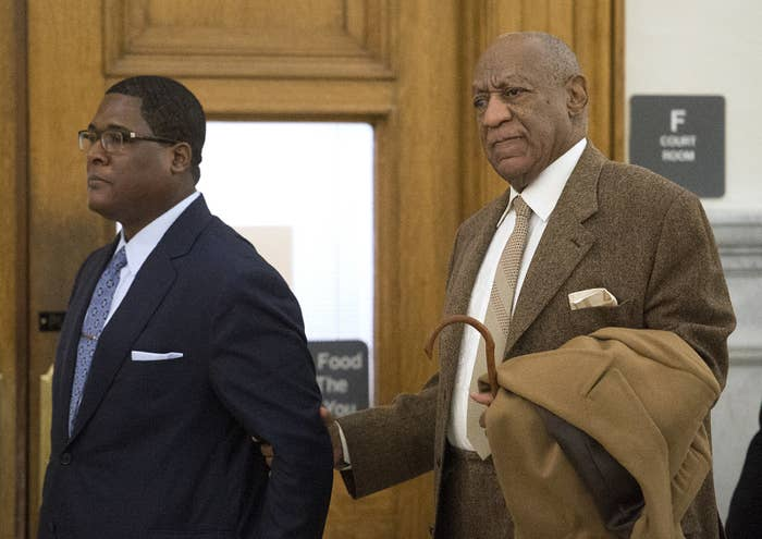 Bill Cosby, with the help of an aid, returns to court in Norristown, Penn.