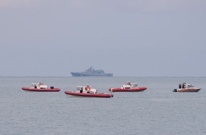 Russian rescuer boats patrol off the coast of the Black Sea looking for debris.