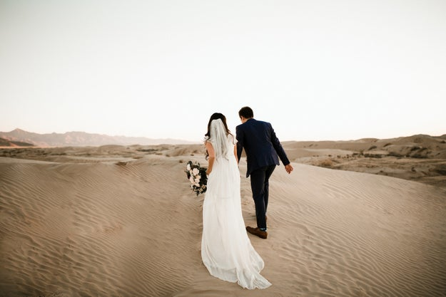 This couple that makes walking in the desert in formal wear look easy.