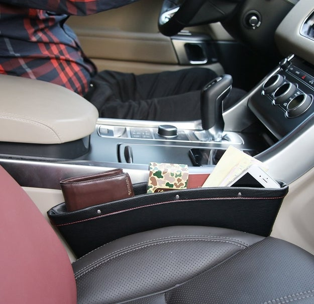 Fill the gaps besides your seats with these neat Car Seat Catchers ($9). You will literally never lose your phone again and you have a spot to quickly stow your stuff.