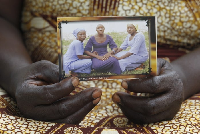 """ABUJA, Nigeria — """"One of our daughters may be returning to us.""""It was an otherwise ordinary spring evening in Abuja when the text message flashed up on Esther Yakubu's phone, and suddenly she was filled with hope — and fear.As she always did when she got a message like this, she ran through what it might mean: Could it be that, after two long years, she might finally hear her missing daughter's voice again? Was Dorcas about to return to reclaim her place in the family as big sister to her five siblings? Would this bring an end to the sleepless nights spent imagining her daughter's fate at the hands of a sect that has burned schoolchildren alive?"""
