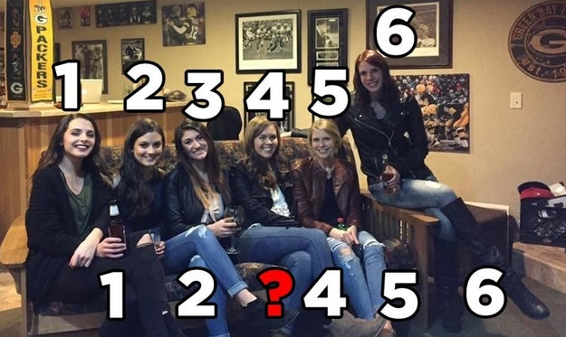 The photo seems straightforward enough until you realize that there are six women but only five pairs of legs.