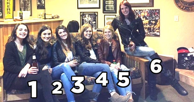 So to reiterate, the first two women are wearing black jeans and have their legs close together, which makes it look like one pair of legs and creates the illusion that the woman in the middle doesn't have any legs at all.