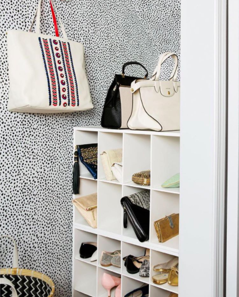 Add a level of luxury by sticking some removable wallpaper to the back wall of your closet.