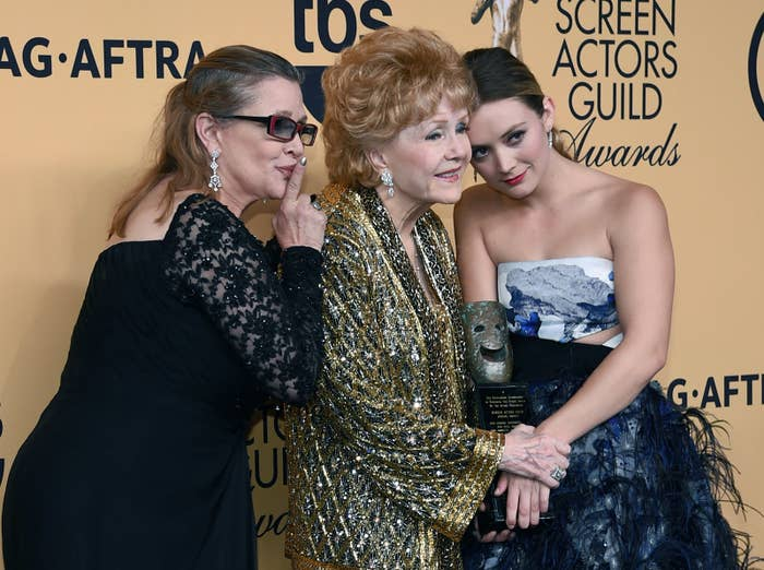 LOS ANGELES, CA - JANUARY 25: (L-R) Actresses Carrie Fisher, Screen Actors Guild Life Achievement Award recipient Debbie Reynolds, and Billie Lourd pose in the press room during the 21st Annual Screen Actors Guild Awards at The Shrine Auditorium on January 25, 2015 in Los Angeles, California. (Photo by Ethan Miller/Getty Images)