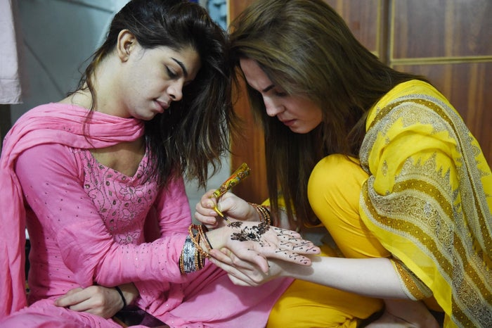 Pakistani transgenders decorate hands with henna ahead of the Eid al-Fitr festival