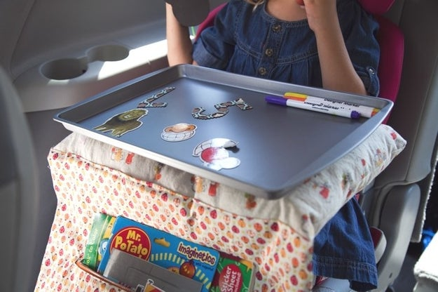 You can also make them this travel lap tray which is great for coloring, playing games, and napping — in addition to keeping their food from destroying your interior.