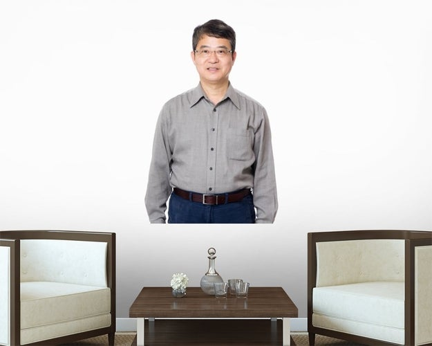 A vinyl wall decal of half an Asian businessperson.