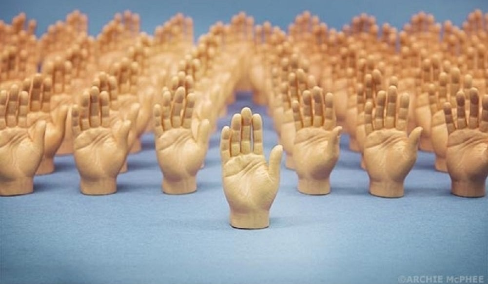 A set of small hands that you place on each finger to make it look like your fingers have fingers.
