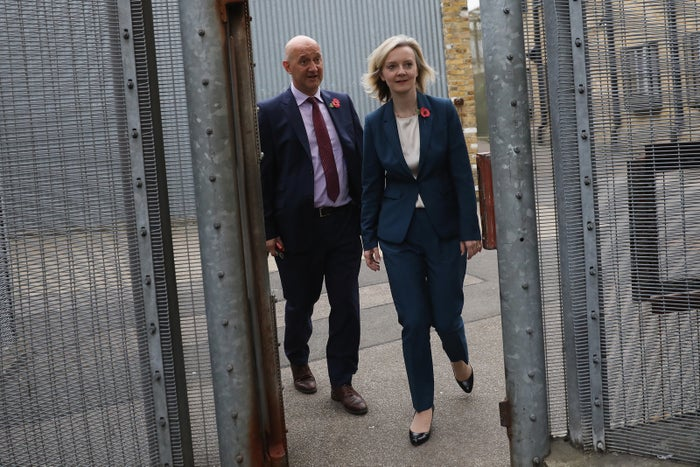 The justice secretary Liz Truss is escorted around HMP Brixton by the prison governor.