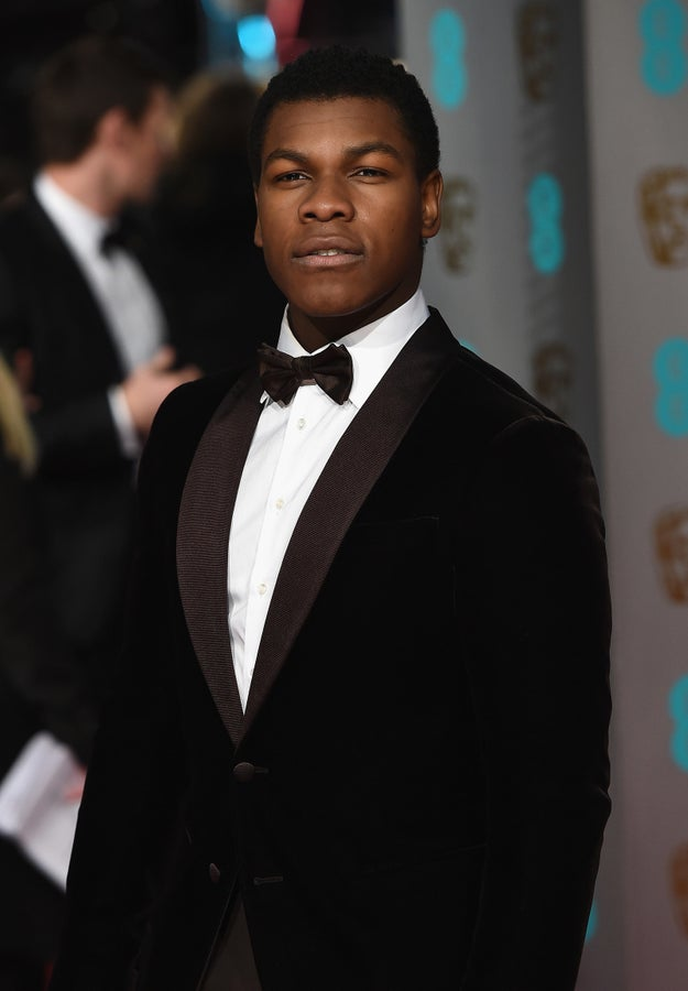 And John Boyega would like to show you his Star Wars blaster.