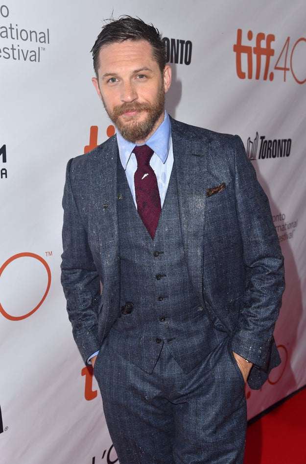 Tom Hardy is rocking that three-piece suit like his life depended on it.