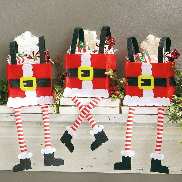 Felt Santa bags with legs that dangle over your mantle.
