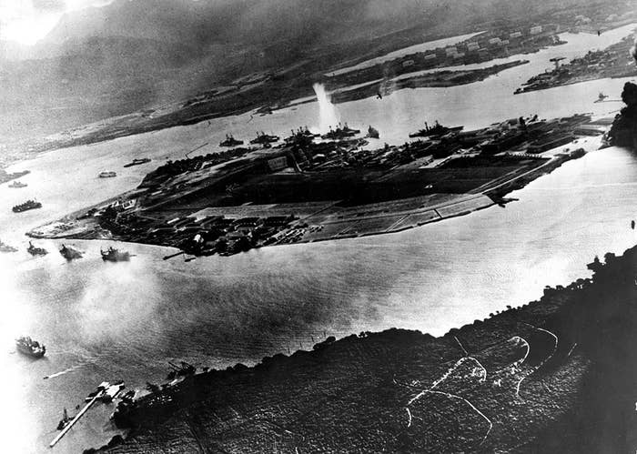An aerial view of Pearl Harbor with Ford Island and Ford air base after the air raid by the Imperial Japanese Navy. On the morning of Dec. 7, 1941, a surprise military attack was conducted by aircraft of the Imperial Japanese Navy against the US Pacific Fleet being moored in Pearl Harbor, marking the entry of the US in World War II. More than 2,400 people were killed and thousands wounded, with dozens of Navy vessels either sunk or destroyed.