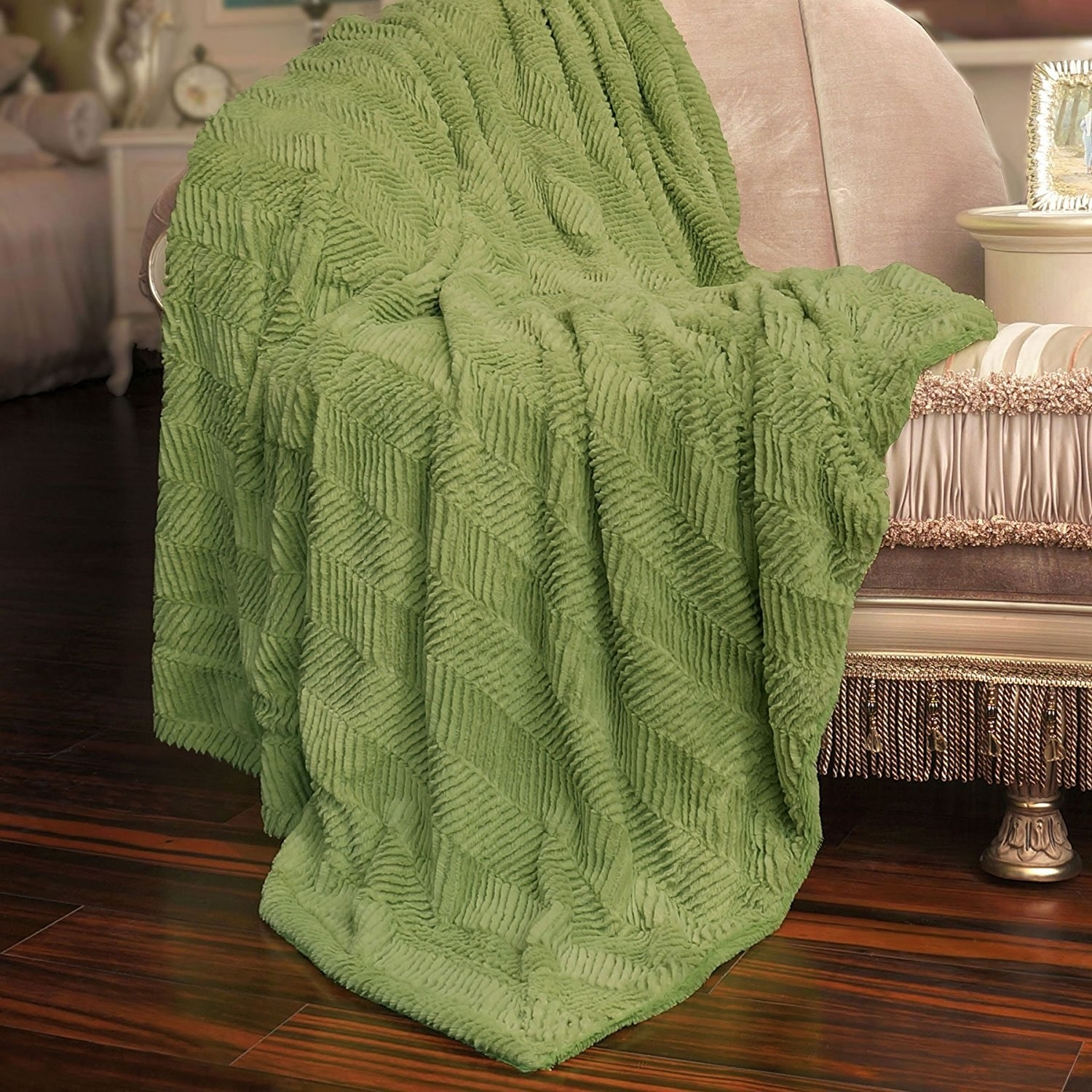 green herringbone texture blanket on a fancy couch