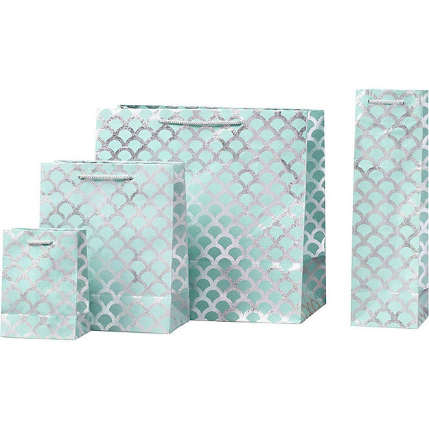 Silver scalloped gift bags that are (mer)made for only the prettiest presents.