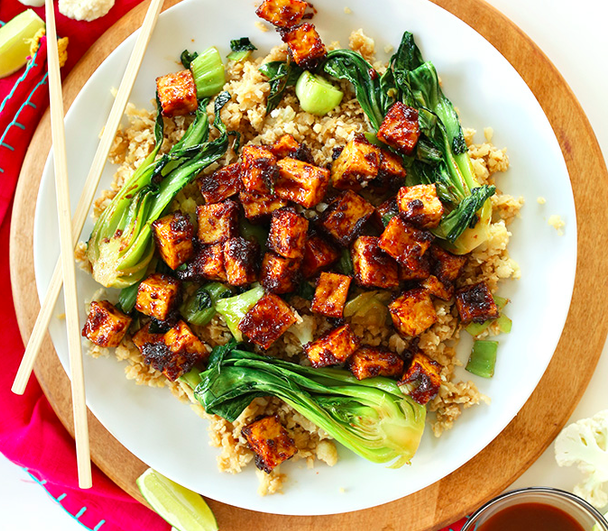Skip the takeout and make this low-carb, highly delicious crispy peanut tofu and cauliflower rice stir-fry.