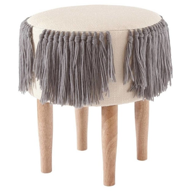 Park a tray on top of this fringed Nate Berkus stool as extra tabletop space when you aren't using it as a footrest.