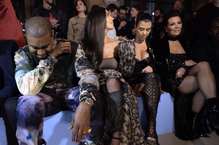 Kanye West, Kim Kardashian West, Kourtney Kardashian, and Kris Jenner at a fashion show in Paris.