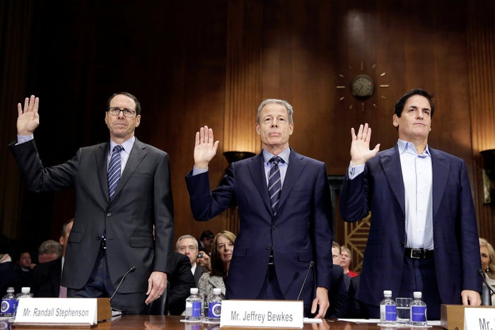 Chairman and CEO of AT&T Randall Stephenson, Chairman and CEO of Time Warner Jeffrey Bewkes, and Chairman of AXS TV and owner of the Dallas Mavericks Mark Cuban are sworn in before a Senate Judiciary Committee Antitrust Subcommittee hearing on the proposed deal between AT&T and Time Warner on December 7, 2016.
