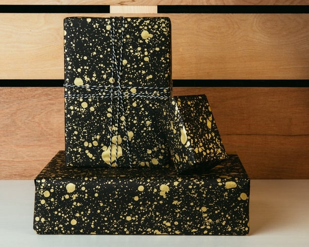 Gold splattered paper to make any present Pollock-esque.