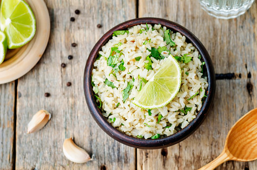 For fluffy rice, when almost all the water has evaporated, drop in a few drops of lime juice.