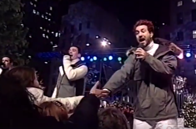 And Joey Fatone shows his fans some love while wearing a classic puffy jacket with a fur-lined hood.