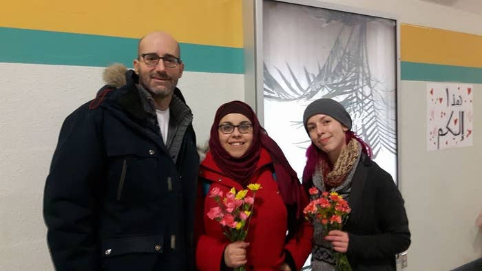 """Nakita Valerio (centre), a graduate student, saw Venne's callout and jumped on board.""""I thought it was first of all beautiful, I would love to be a person to receive that flower,"""" Valerio told BuzzFeed Canada. """"A non-Muslim taking the initiative to make Muslim women feel safe and comfortable in the city — it was just something that had to be endorsed."""""""