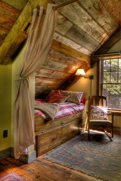 Have a small space? Create a bed nook of your very own by installing a space-separating curtain.