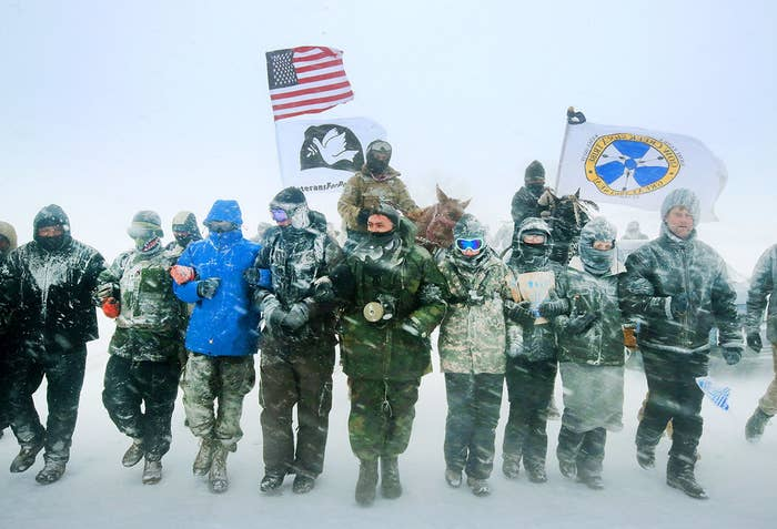 """Despite blizzard conditions, military veterans march in support of the """"water protectors"""" at Oceti Sakowin Camp on the edge of the Standing Rock Sioux Reservation, outside Cannon Ball, North Dakota. Over the weekend a large group of military veterans joined native Americans and activists from around the country who have been at the camp for several months trying to halt the construction of the Dakota Access Pipeline. On Dec. 4, the US Army Corps of Engineers announced that it will not grant an easement for the pipeline to cross under a lake on the Sioux Tribes Standing Rock reservation."""